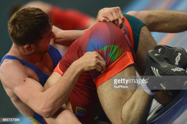 Ruslan Sadybakasov of Kyrgyzstan competes against Raxmatulla Muslimov Murtazali of Azerbaijan in the Mens Freestyle Wrestling 70kg semifinals during...