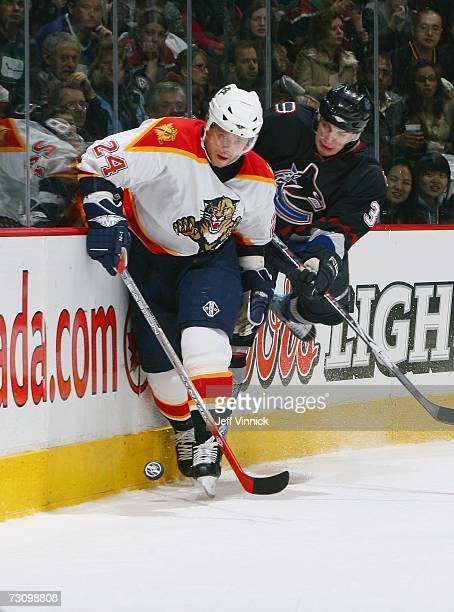 Ruslan Salei of the Florida Panthers battles for the puck against Jan Bulis of the Vancouver Canucks at General Motors Place on January 7, 2007 in...