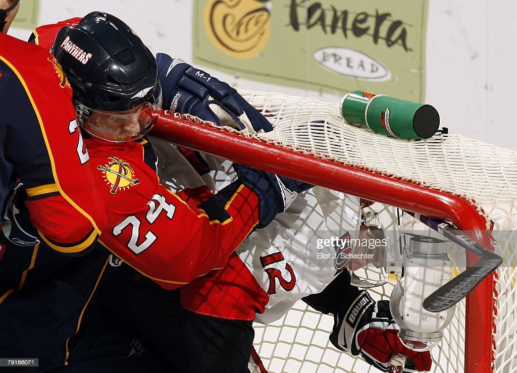 Ruslan Salei #24 of the Florida Panthers shoves Mike Fisher #12 of the Ottawa Senators into the net at the Bank Atlantic Center on January 22, 2008 in Sunrise, Florida.