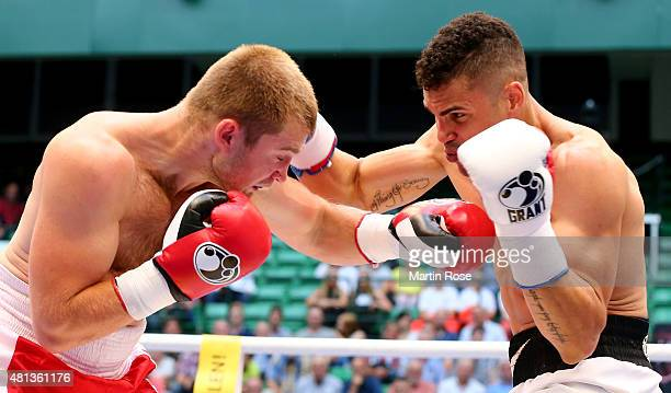 Ruslan Schelev of Ukraine exchange punches with Anthony Ogogo of Great Britain during the middleweight fight at Gerry Weber Stadium on July 18 2015...