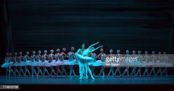 Ruslan Skvortsov and Maria Alexandrova of the Bolshoi Ballet perform during a photocall for 'Swan Lake' at The Royal Opera House on July 29 2013 in...