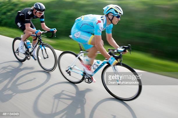 Ruslan Tleubayev of Kazakhstan and Luke Rowe of Great Britain compete in the E3 Harelbeke Cycle Race on March 28, 2014 in Harelbeke, Belgium.