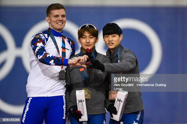 Ruslan Zakharov of Russia and Jae Woong Chung and Seonghyeon Park of Korea stand on the podium after the men's 500 meter final during the ISU Junior...