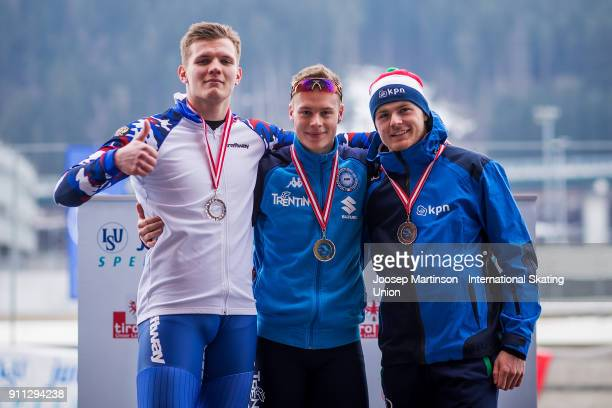 Ruslan Zakharov of Russia Jeffrey Rosanelli of Italy and Stef Brandsen of Netherlands pose in the Men's 500m medal ceremony during day two of the ISU...