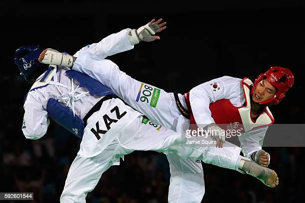 Ruslan Zhaparov of Kazakhstan competes against Dongmin Cha of Korea during the Men's 80kg Repechage contest on Day 15 of the Rio 2016 Olympic Games...