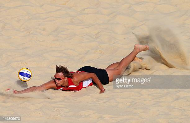 Ruslans Sorokins of Latvia dives for the ball during the Men's Beach Volleyball Round of 16 match between Germany and Latvia on Day 8 of the London...
