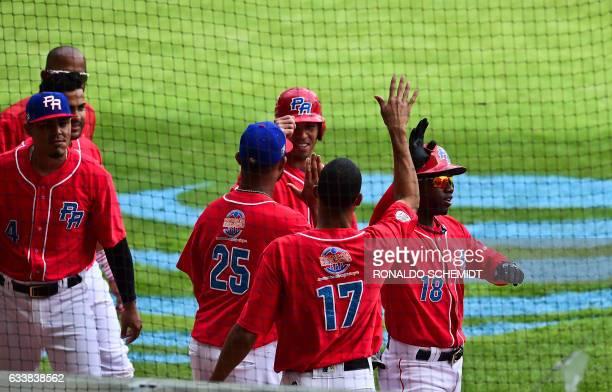 Rusney Castillo of Criollos de Caguas of Puerto Rico celebrates after scoring against Tigres del Licey of the Dominican Republic during the Caribbean...