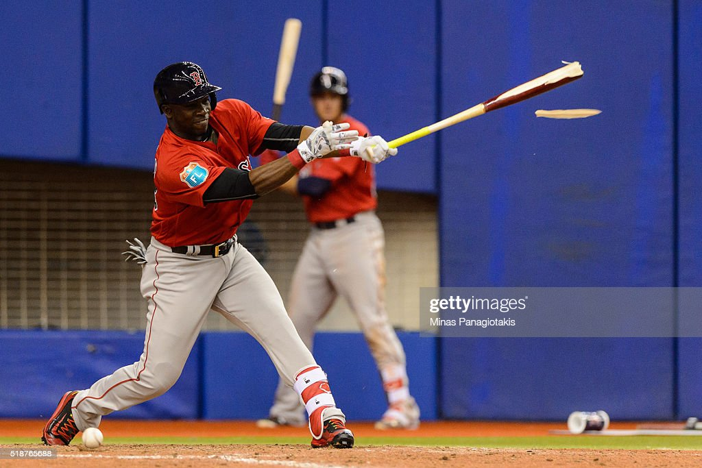 Rusney Castillo #38 of the Boston Red Sox breaks his bat in the top of the ninth during the MLB spring training game against the Toronto Blue Jays at Olympic Stadium on April 2, 2016 in Montreal, Quebec, Canada. The Boston Red Sox defeated the Toronto Blue Jays 7-4.