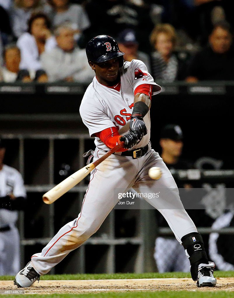 Rusney Castillo #38 of the Boston Red Sox hits a two-run double against the Chicago White Sox during the sixth inning at U.S. Cellular Field on August 24, 2015 in Chicago, Illinois.