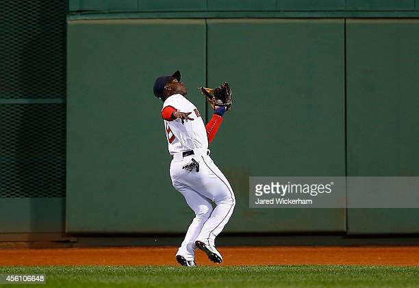 Rusney Castillo of the Boston Red Sox makes a catch in center field in the sixth inning against the Tampa Bay Rays during the game at Fenway Park on...