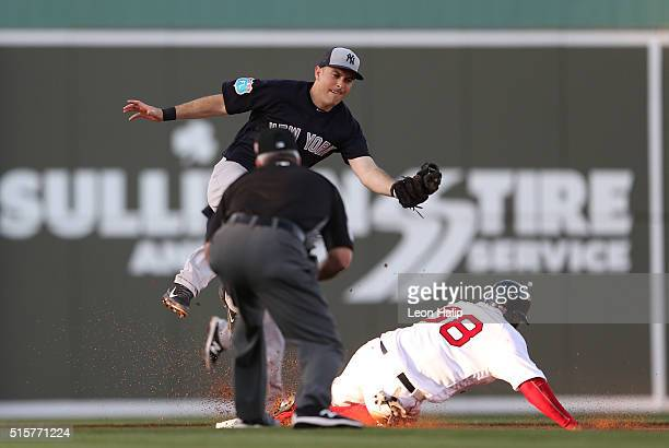 Rusney Castillo of the Boston Red Sox slides safely into second base as Pete Kozma of the New York Yankees attempts to make the tag during the second...