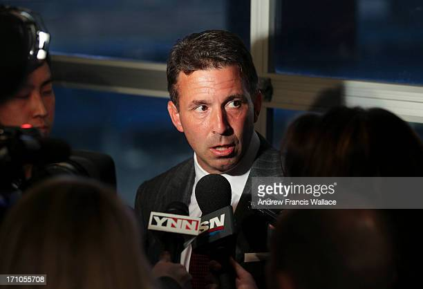 Russ Brandon President and CEO Buffalo Bills speaks to media after announcing a new multiyear partnership with Rogers at the Rogers Centre in Toronto...