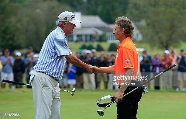 Russ Cochran is congratulated by Bernhard Langer of Germany on the 18th green as Cochran wins the SAS Championship held at Prestonwood Country Club...