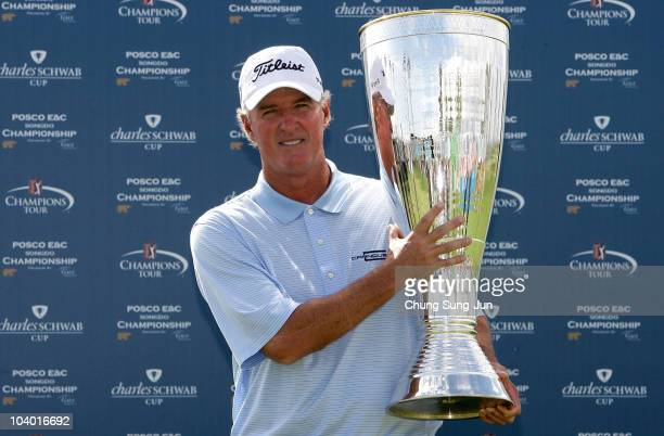 Russ Cochran of United States poses with the tournament trophy during the final round of the PGA Champions Tour - Posco E&C Songdo Championship at...