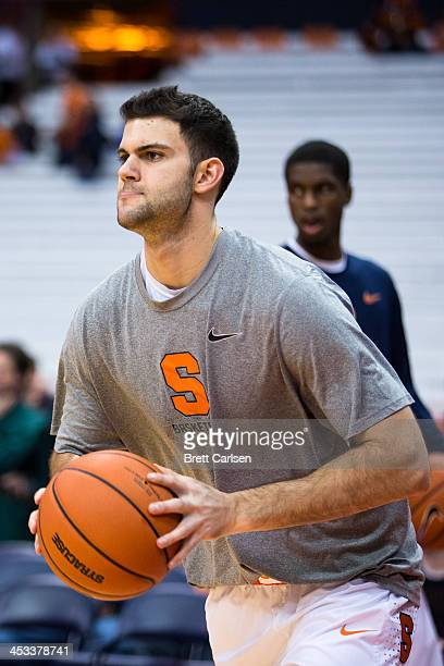 Russ Deremer of Syracuse Orange warms up with teammates before a basketball game against St Francis Terriers on November 18 2013 at the Carrier Dome...