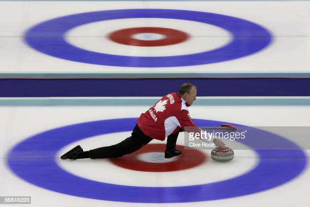 Russ Howard of Canada in action during the preliminary round of the Men's curling between Canada and Sweden during Day 4 of the Turin 2006 Winter...