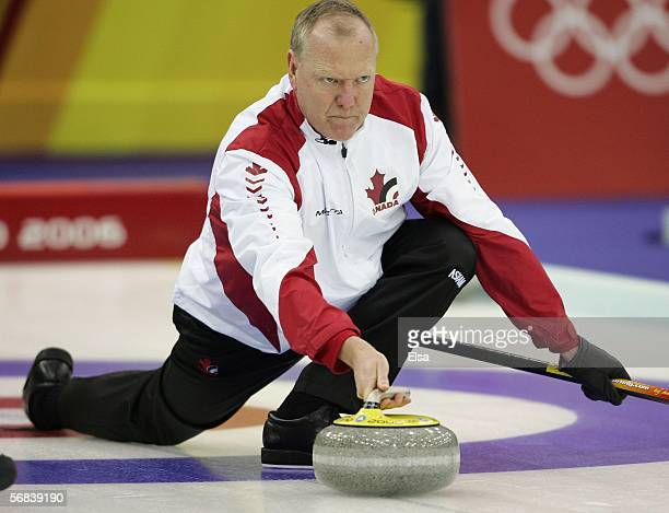 Russ Howard of Canada lines up the stone during the preliminary round of the men's curling between Canada and Germany during Day 3 of the Turin 2006...