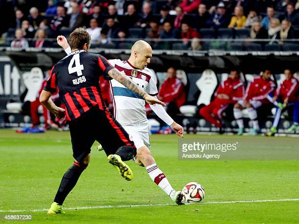 Russ of Eintracht Frankfurt in action against Robben of Bayern München during the Bundesliga soccer match between Eintracht Frankfurt and Bayern...