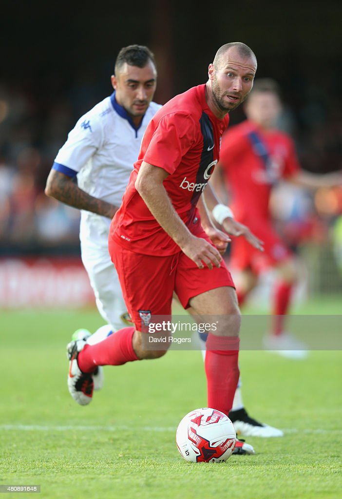 Russ Penn of York City runs with the ball during the pre season friendly match between York City and Leeds United at Bootham Crescent on July 15, 2015 in York, England.