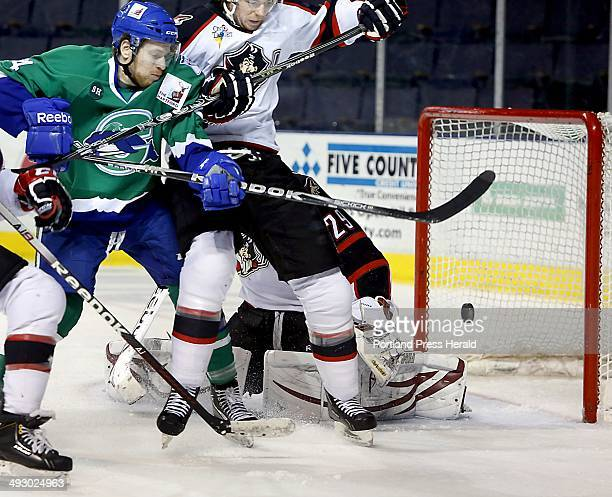 Russ Sinkewich of the Portland Pirates prevents Sean Collins of the Connecticut Whale from going after the puck as it sails just wide of the goal and...