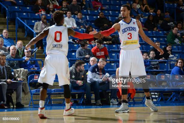 Russ Smith and James Webb III of the Delaware 87ers slap hands during the game against the Maine Red Claws on February 14 2017 at the Bob Carpenter...