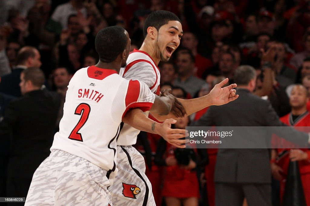 Russ Smith #2 and Peyton Siva #3 of the Louisville Cardinals celebrate after they won 78-61 against the Syracuse Orange during the final of the Big East Men's Basketball Tournament at Madison Square Garden on March 16, 2013 in New York City.