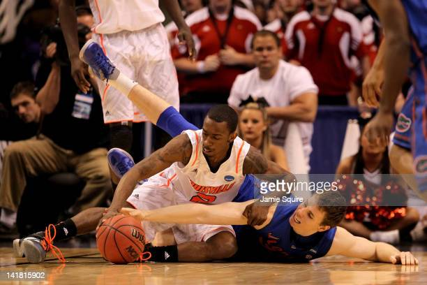 Russ Smith of the Louisville Cardinals and Erik Murphy of the Florida Gators battle for a loose ball in the second half during the 2012 NCAA Men's...