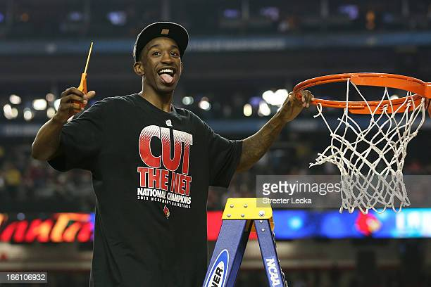 Russ Smith of the Louisville Cardinals celebrates as he cuts down the net after they won 8276 against the Michigan Wolverines during the 2013 NCAA...