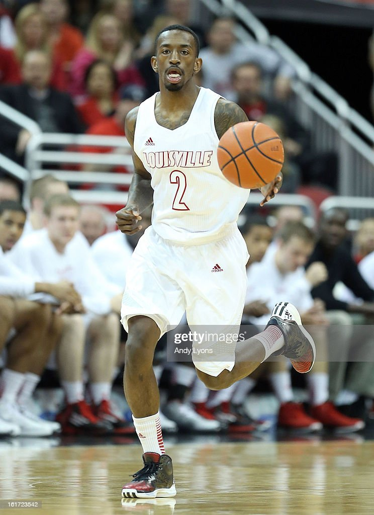 Russ Smith #2 of the Louisville Cardinals dribbles the ball during the game against the St. John's Red Storm at KFC YUM! Center on February 14, 2013 in Louisville, Kentucky.