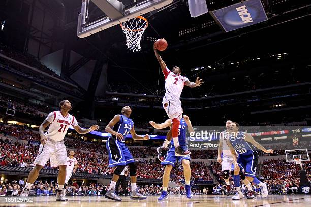 Russ Smith of the Louisville Cardinals drives for a shot attempt in the first half against Rasheed Sulaimon of the Duke Blue Devils during the...