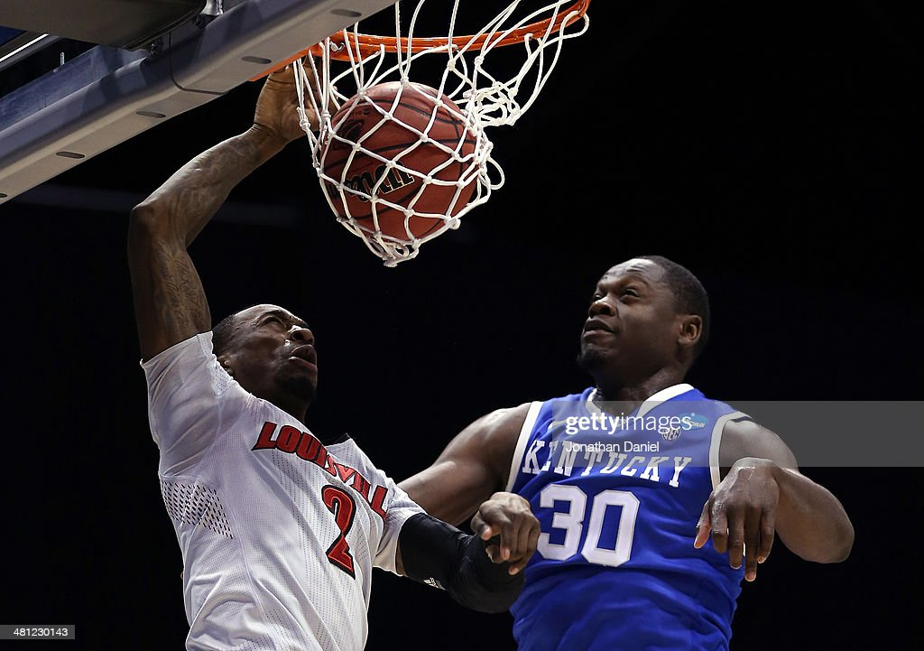 Russ Smith #2 of the Louisville Cardinals dunks the ball over Julius Randle #30 of the Kentucky Wildcats during the regional semifinal of the 2014 NCAA Men's Basketball Tournament at Lucas Oil Stadium on March 28, 2014 in Indianapolis, Indiana.