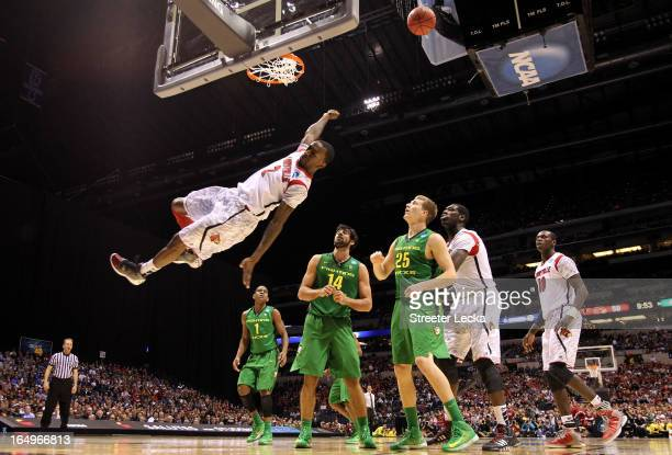 Russ Smith of the Louisville Cardinals falls to the court afterhe missed a dunk attempt in the second half against the Oregon Ducks during the...