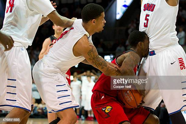 Russ Smith of the Louisville Cardinals is trapped by the SMU Mustangs defense on February 5 2014 at Moody Coliseum in Dallas Texas