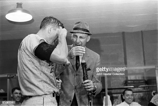 Russ Snyder of the Baltimore Orioles is interviewed by Chuck Thompson as the Orioles celebrate clinching the American League pennant in the clubhouse...
