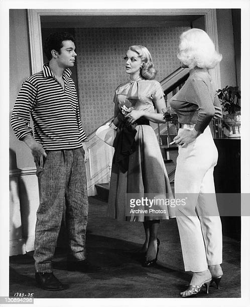 Russ Tamblyn facing Jan Sterling and Mamie Van Doren in a scene from the film 'High School Confidential!', 1958.
