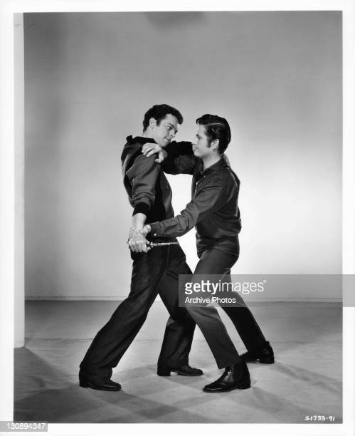 Russ Tamblyn fighting John Drew Barrymore in a scene from the film 'High School Confidential' 1958