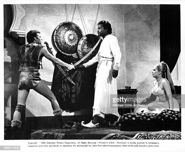 Russ Tamblyn fights Sidney Poitier as Beba Loncar watches in a scene from the film 'The Long Ships' 1964