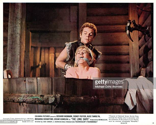Russ Tamblyn kidnaps Beba Loncar in a scene from the film 'The Long Ships' 1964