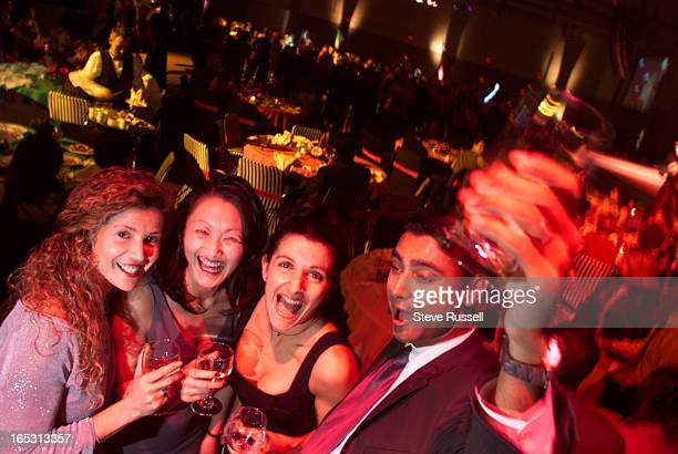 Antonella Schirripa, Elsa Chan, Marina Lobo and Jeremy Lobo whoop it up at the ClearNET Christmas Party at the Metro convention centre in Toronto,...