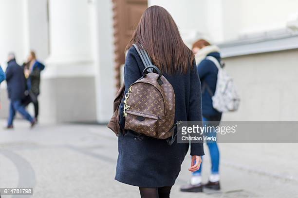Russain model Ksana Lankovskis wearing a Louis Vuitton backpack and scarf and navy wool coat on October 14 2016 in Moscow Russia