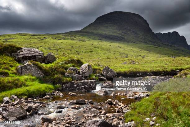 russel burn river under sgurr a chaorachain peak at the bealach na ba road mountain pass on applecross peninsula western ross scotland uk - wester ross stock pictures, royalty-free photos & images