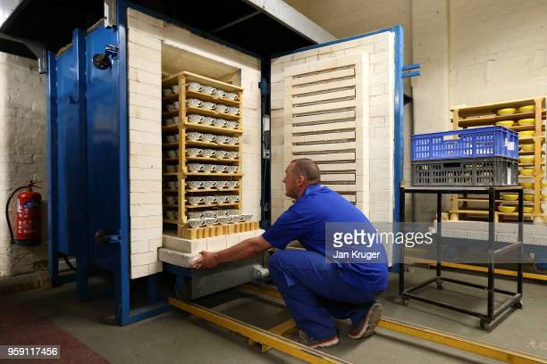 Russel Ellis removes special edition baked tea cups from a kiln ahead of the wedding of Prince Harry and Meghan Markle at William Edwards Home Ltd on...