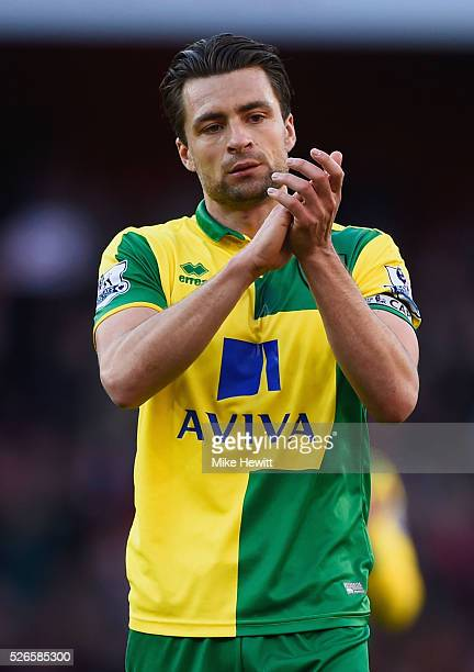 Russel Martin of Norwich City applauds the travelling fans after the Barclays Premier League match between Arsenal and Norwich City at The Emirates...
