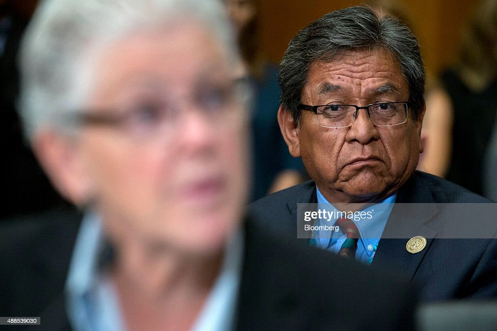 Russell Begaye, president of the Navajo Nation, right, looks on as Gina McCarthy, administrator of the Environmental Protection Agency (EPA), speaks during a Senate Environment and Public Works Committee hearing on the Gold King mine disaster in Washington, D.C., U.S., on Wednesday, Sept. 16, 2015. The August spill occurred when contractors for the EPA tried to open the blocked Gold King Mine to address leaks near Silverton, Colorado, accidentally releasing the toxic mining wastewater into the Animas River. Photographer: Andrew Harrer/Bloomberg via Getty Images