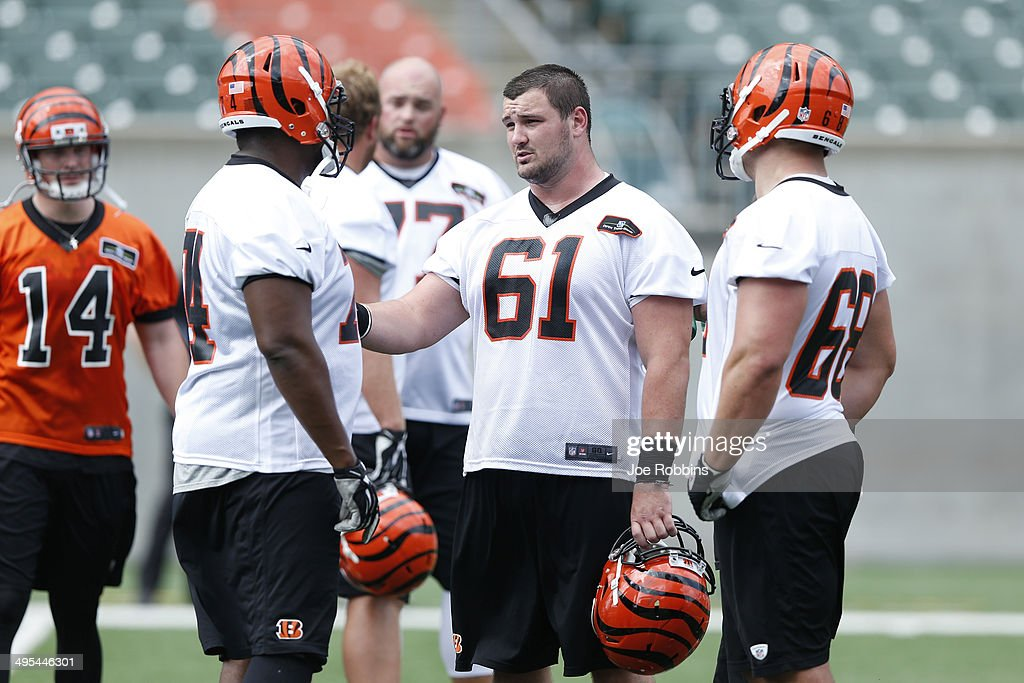 Russell Bodine #61 of the Cincinnati Bengals talks with teammates during an organized team activity (OTA) workout at Paul Brown Stadium on June 3, 2014 in Cincinnati, Ohio.