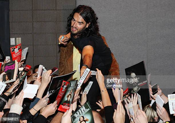 Russell Brand greets fans backstage after his stand-up show at the Sydney Entertainment Centre on June 10, 2010 in Sydney, Australia.