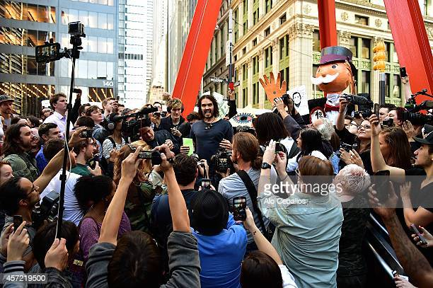 Russell Brand is seen in Wall Street on October 14 2014 in New York City