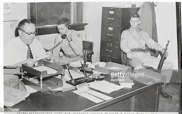 Russell County Sheriff H Ralph Mathews cleans out his desk at the courthouse in Phenix City after his job and officer were taken over by Alabama...