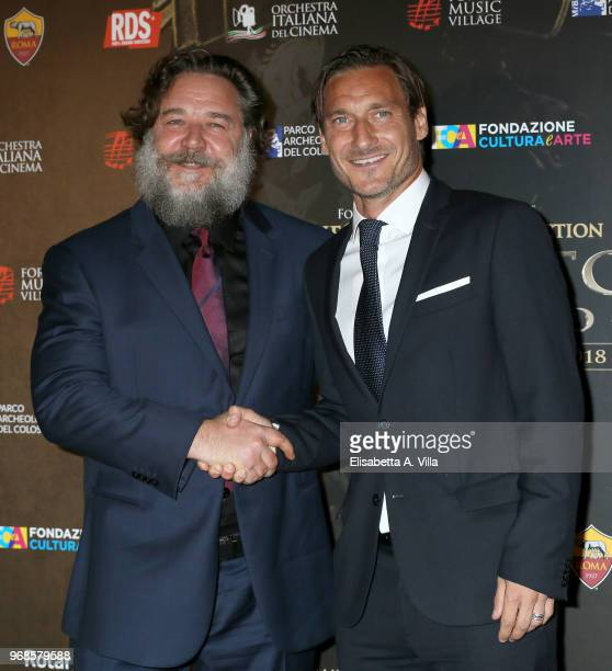 Russell Crowe and Francesco Totti attend the 'Il Gladiatore In Concerto' charity night at Colosseum on June 6 2018 in Rome Italy
