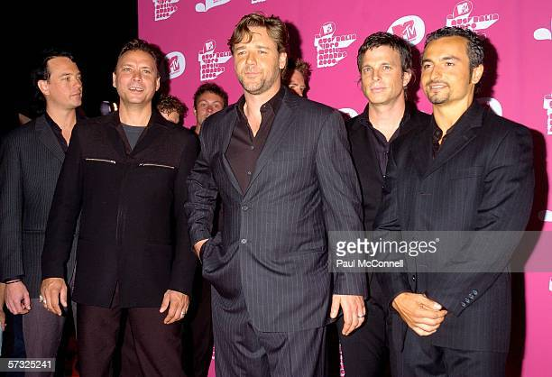 Russell Crowe and his band The ordinary Fear of God pose as they arrive for the second MTV Australia Video Music Awards at the Sydney SuperDome April...